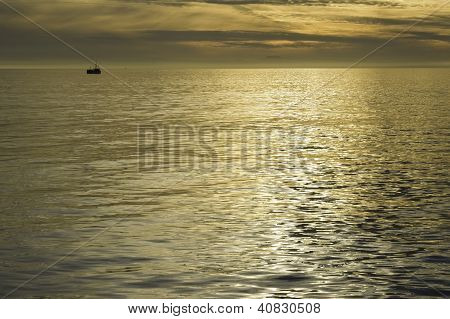 Distant Boat On Reflective Seascape