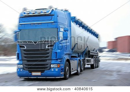 Blue Tanker Truck with Motion Blur