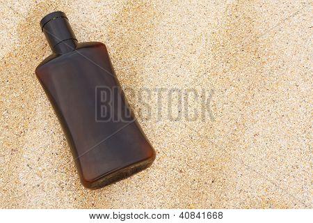 Sun Tan Oil On Sand