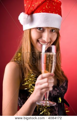Smiling Mrs. Santa With Champagne