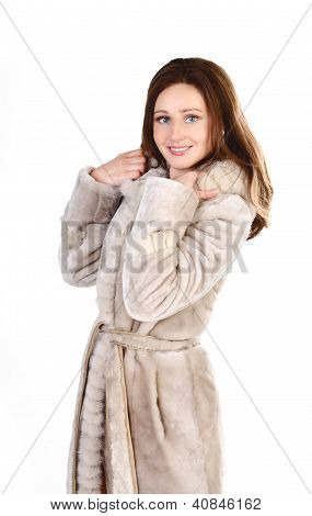 Attracive Young Woman In A Fur Coat Isolated