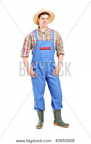 Full length portrait of a young male farmer smiling isolated on white background
