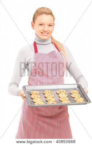 Female houswife with apron, holding freshly baked cakes