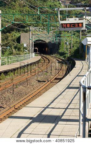 Kasashima Japan Oct 23 2010-Train Arriving At Rural Japanese Station.