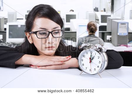 Businesswoman Looking At Deadline