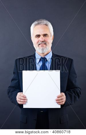 Handsome business man holding blank card