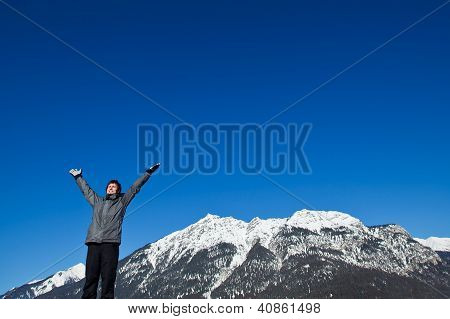 skier on top of the mountains