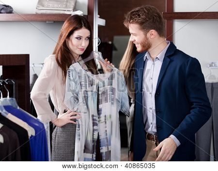 Woman insists that her boyfriend to present her a new dress