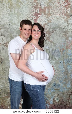 Maternity photos of a couple in studio - 8 months pregnant