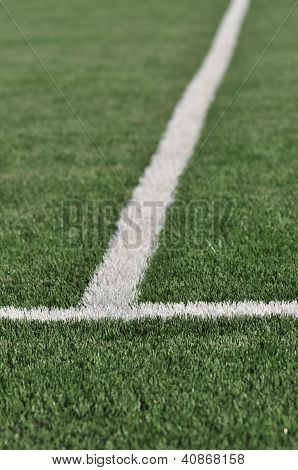 Lines intersect on a turf field of play