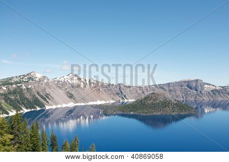 Cloudless Wizard Island of Crater Lake during the summer