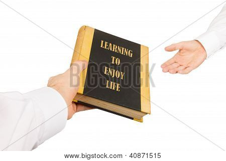Businessman Giving An Used Book To Another Businessman