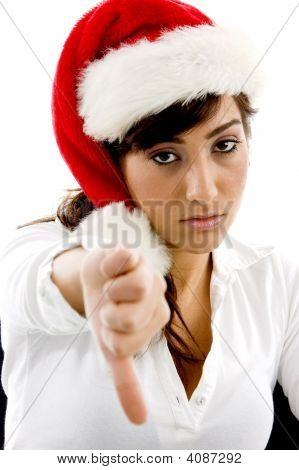 Front View Of Disappointed Businesswoman In Christmas Hat With Thumbs Down