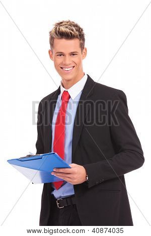 Portrait of a male business executive taking a notes on clipboard against white background