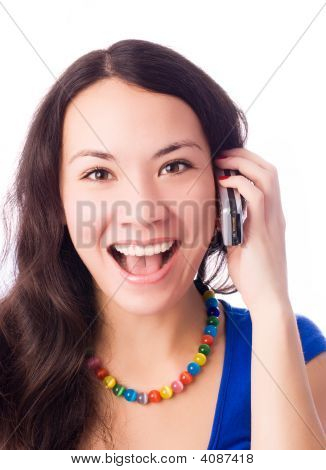 Excited Young Woman Talking On The Cell-Phone