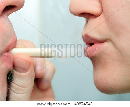 People Enjoying Smoking Marijuana Joint Closeup