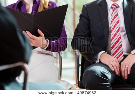 Man having an interview with manager and partner employment job candidate hiring resume CEO work business closeup cutout