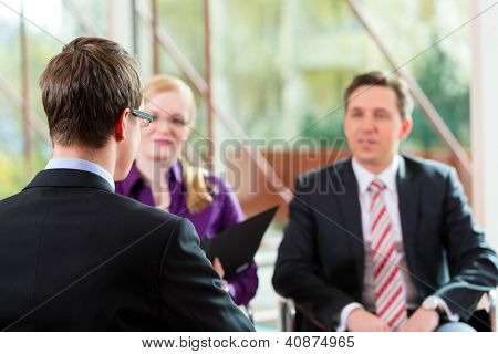 Man having an interview with manager and partner employment job candidate hiring resume CEO work business
