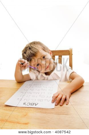 Little Boy Learning To Write.