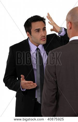 Two businessmen disagreeing