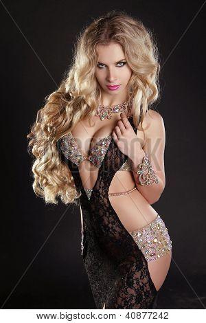 Slim Beautiful Woman With Long Hair Wearing Luxurious Dress Over Dark