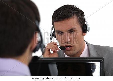 Two male call-center workers