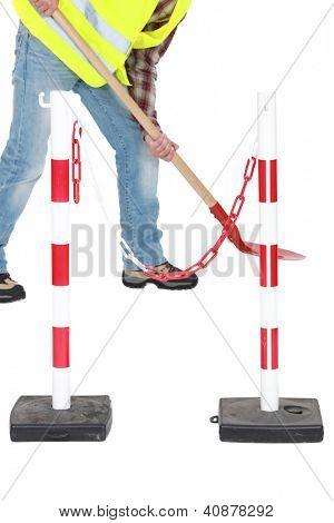 Labourer shovelling during roadworks