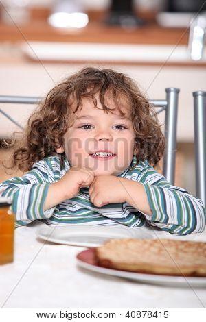 Little girl having crepes for dinner