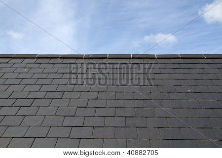 Slate roof against blue sky