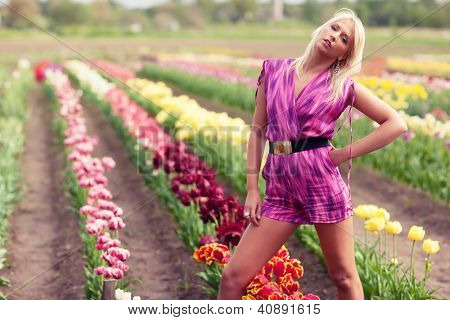 Beautiful blond  girl with tulip flowers, amazing spring photo from Latvia, Baltic states, Europe