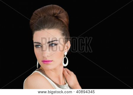 Woman made up in a sixtes mod style on black background