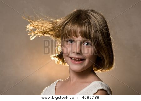 Girl With Wind Blowing Hair Back Light