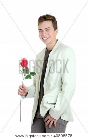 Valentines Day. Portrait Of Young Man Holding The Rose Over The White Background
