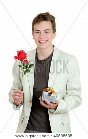 Valentines Day. Portrait Of Young Man Holding The Rose And Gift Over The White Background