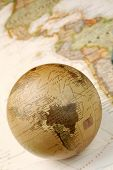 pic of world-globe  - Vintage globe closeup over world map featuring America - JPG