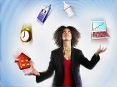 stock photo of responsibility  - Businesswoman juggling responsibilities over colored background - JPG