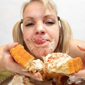 stock photo of anorexic  - The girl greedy eats sweet pie - JPG