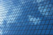stock photo of high-rise  - sky reflecting in windows of office building - JPG