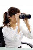 Side View Of Female Accountant Looking Through Binoculars