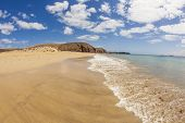 stock photo of papagayo  - beautiful empty papagayo beaches in late afternoon sunshine - JPG