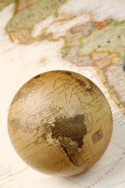 image of world-globe  - Vintage globe closeup over world map featuring America - JPG