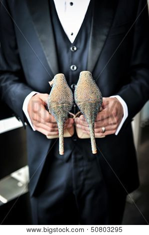 Groom Holding Bridal Shoes