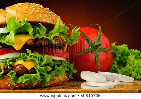 Hamburger Closeup And Vegetables
