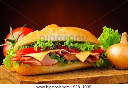 Deli Sub Sandwich And Vegetables