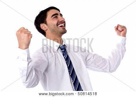 Excited Businessman Celebrates By Pumping Fists