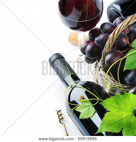 Bottle Of Red Wine With Freshly Harvested Grape