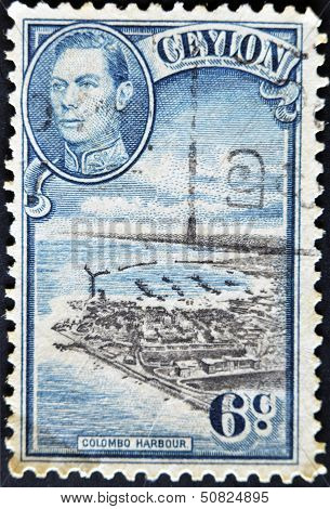 A stamp printed in Ceylon shows image of The Colombo Harbour and King George VI