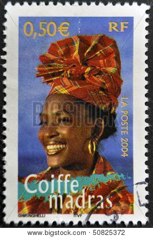 FRANCE - CIRCA 2004: A stamp printed in France shows madras headdress circa 2004