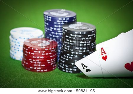 Poker Table With Two Cards And Gambling Chips