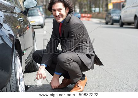 Businessman Repairing Car Roadside